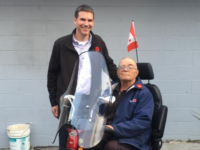 Chris Kehler presents Bert Wiebe with Scooter